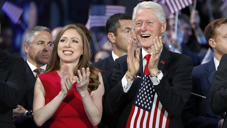Bill, the adoring spouse, in role reversal as Hillary Clinton makes history