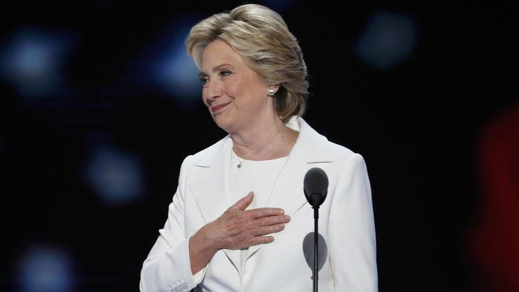 Clinton casts herself as unifier for divided times, experienced leader for volatile world