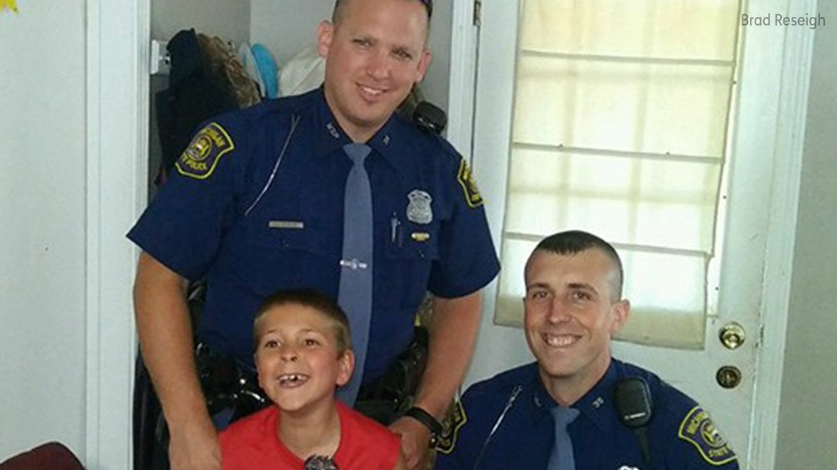 Boy with cerebral palsy gets the surprise of his life when two cops crash his birthday