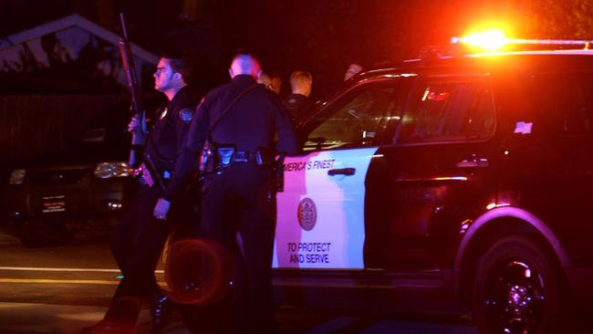 2 San Diego police officers shot, one fatally, in traffic stop; suspect held