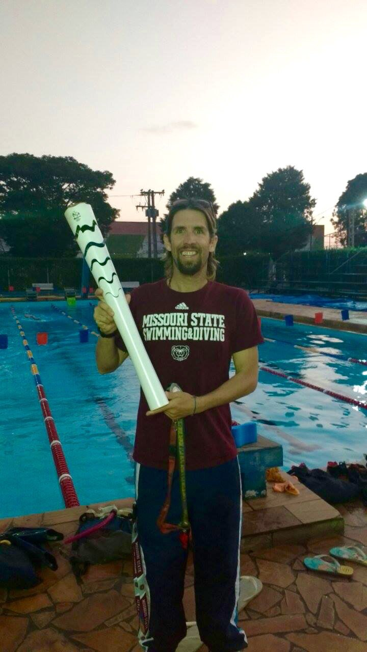 Bearwear Friday Olympic Torch Edition! Nick's club coach Cristian Soldano with the torch as it moved through Brazil https://t.co/URTvDzYnUi