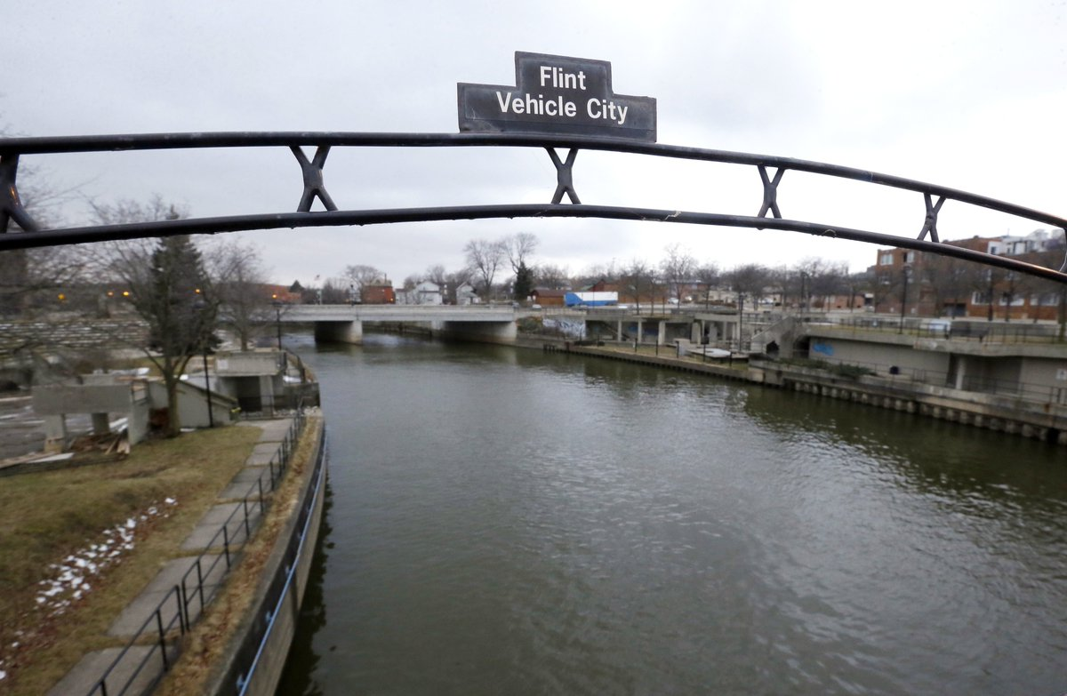 Six Michigan state workers charged in Flint water crisis