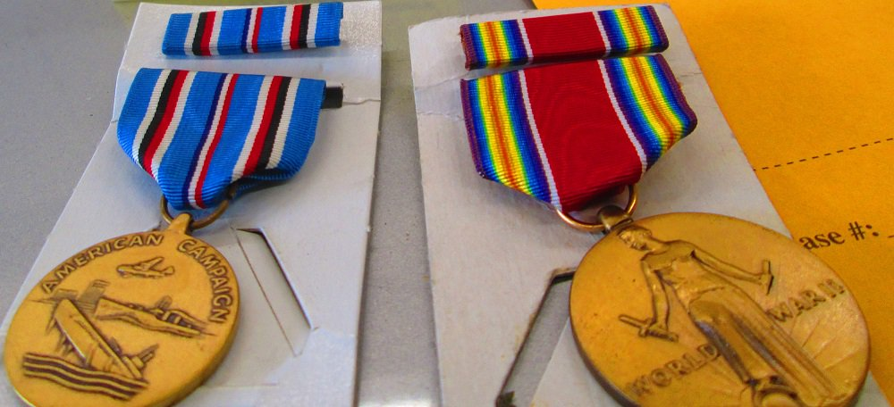 Deputies spot stolen car, arrest gang member, recover stolen property including war medals