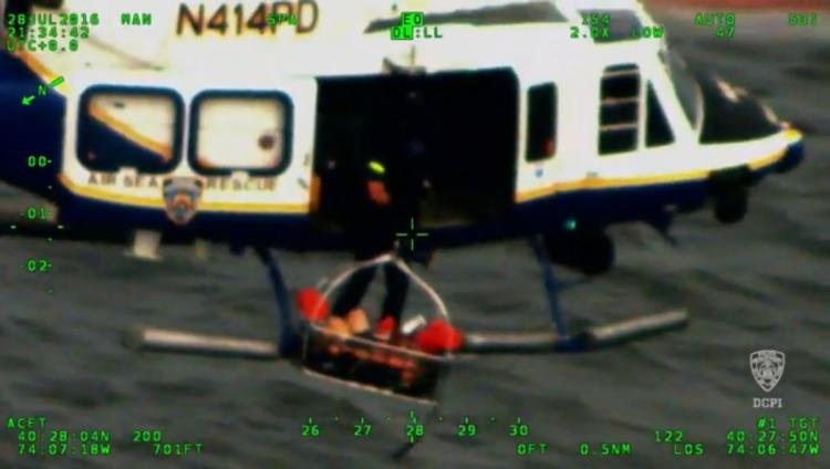 NYPD helicopters and scuba divers rescue man who fell off jet ski into New Jersey waters