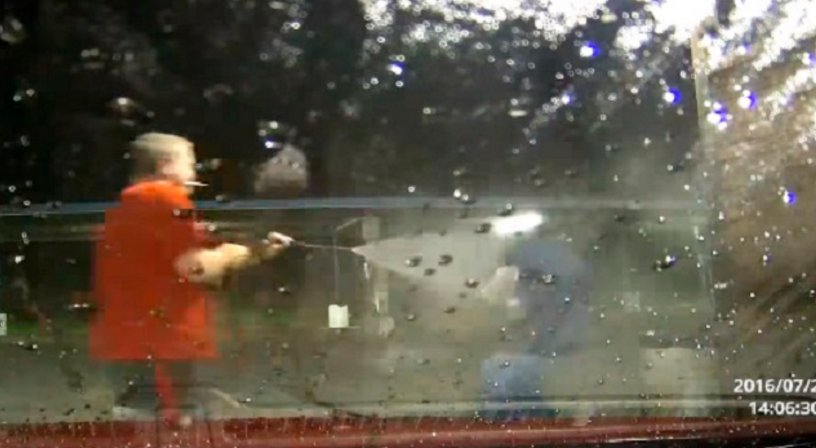 WATCH: Man fights off armed carjackers with a power washer