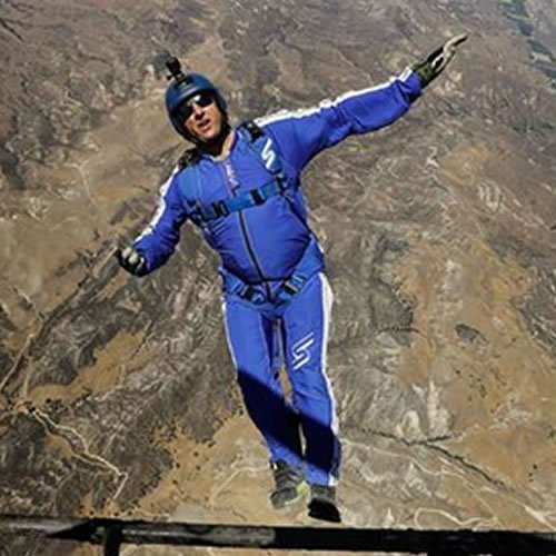 LukeAikins becomes 1st skydiver to successfully jump w/out a parachute, landing in a net.