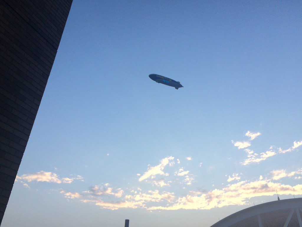 Good Year blimp floats through a calm sky over Progressive Field, Cleveland, Ohio. 9Wx