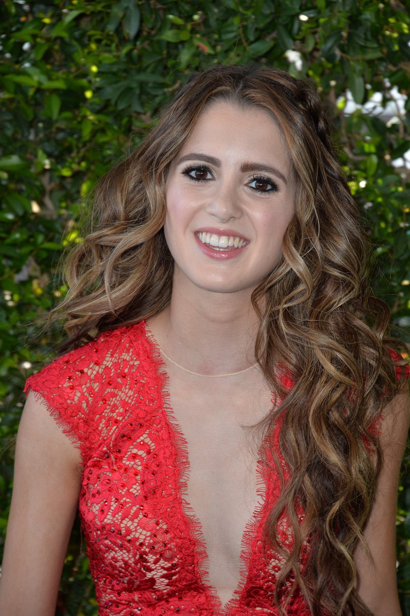 ecb38be890f8 Laura Marano wore a  JOVANI red lace cap-sleeve jumpsuit customized into a  romper to the  TeenChoice Awards.
