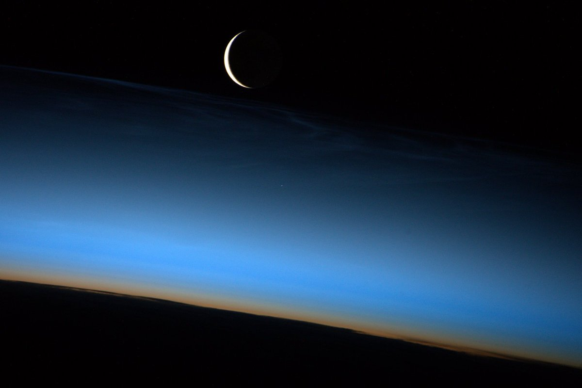 Crescent Moon rising through a subtle display of noctilucent clouds. https://t.co/WWASLTSFGR