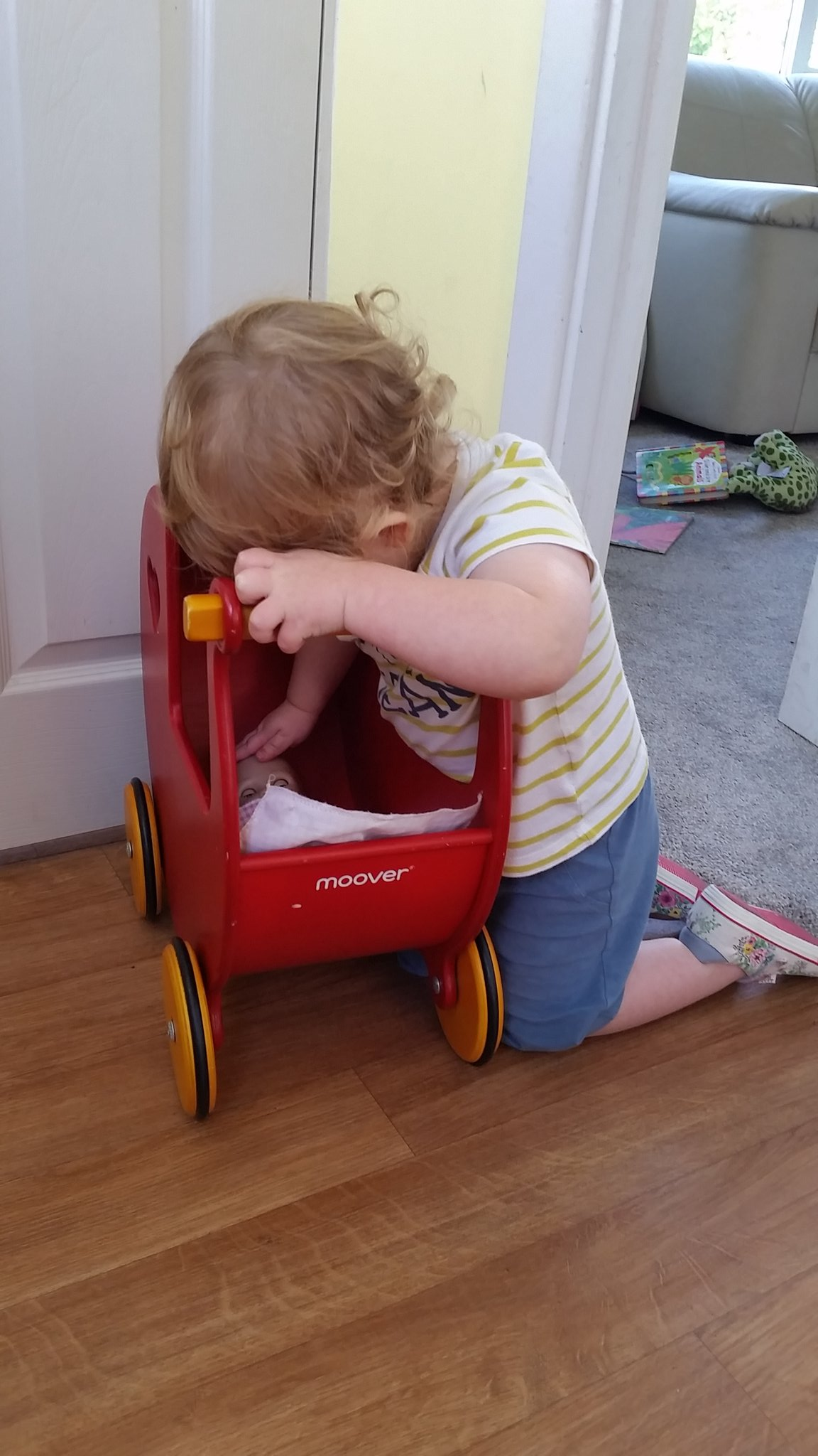 @LetToysBeToys Thought I'd share this of my son putting the baby to sleep wearing his sister's shoes! #caringboys https://t.co/dcCaEayruB