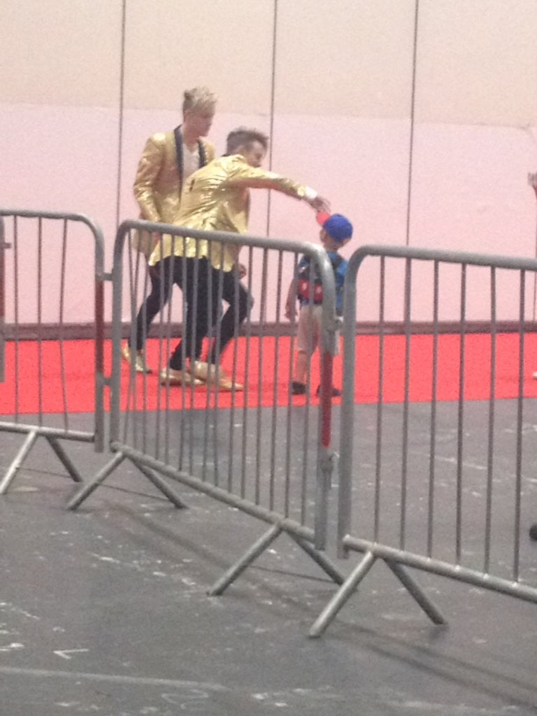 They paused the m&g to go see this little kid that was watching them