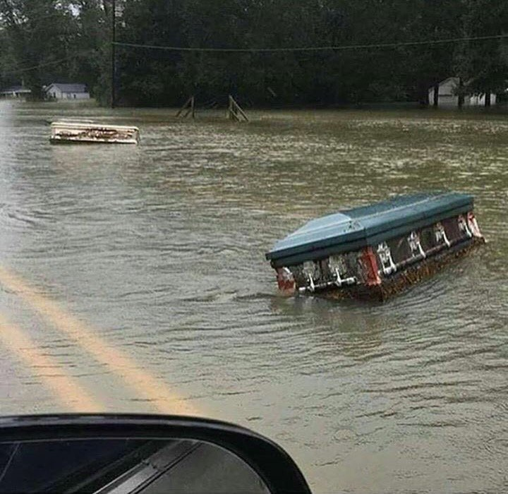 Caskets bubbled up from their graves and floating down the road, from the tragic flooding in Louisiana right now https://t.co/Z6yCtbzTya