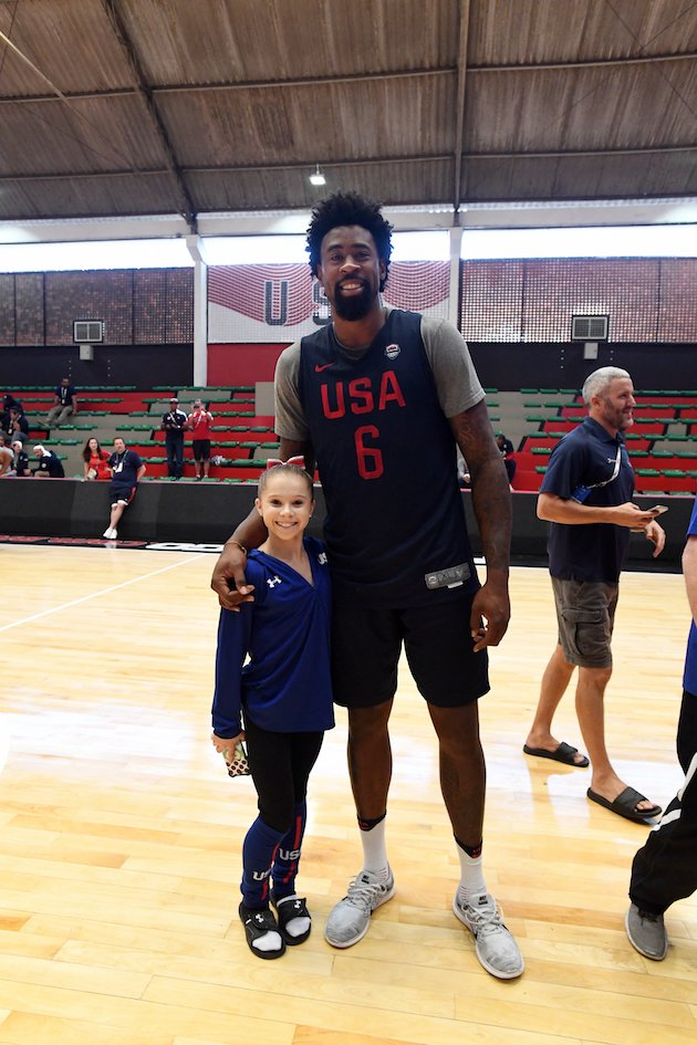 "When a 4'6"" gymnast meets a 6'11"" NBA star #USA 😮"
