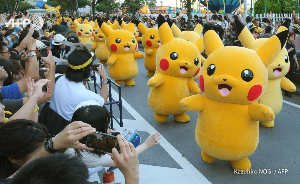 Japan: Parade by Pokemon fans in Pikachu costumes in Yokohama