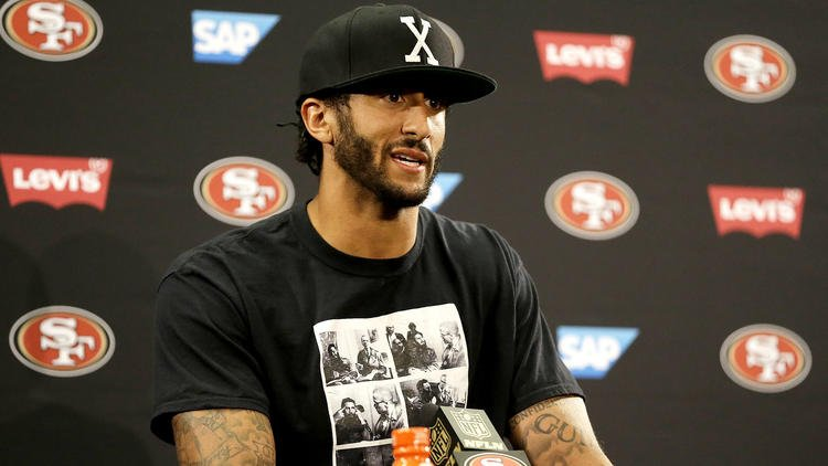 Colin Kaepernick vows to continue sitting during national anthem