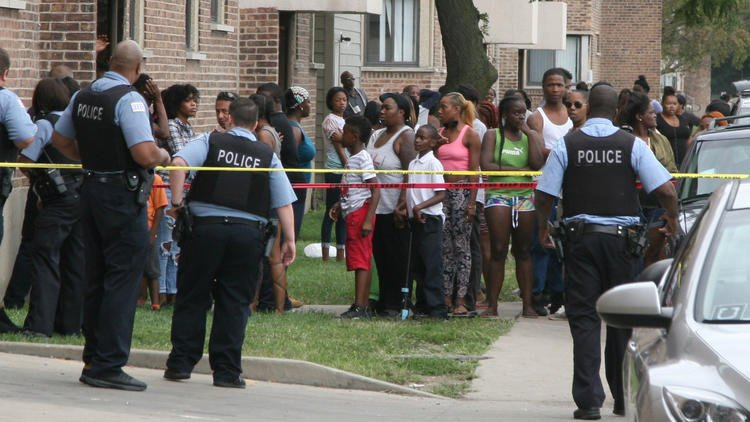 Woman shot dead while pushing baby in a stroller near elementary school on South Side
