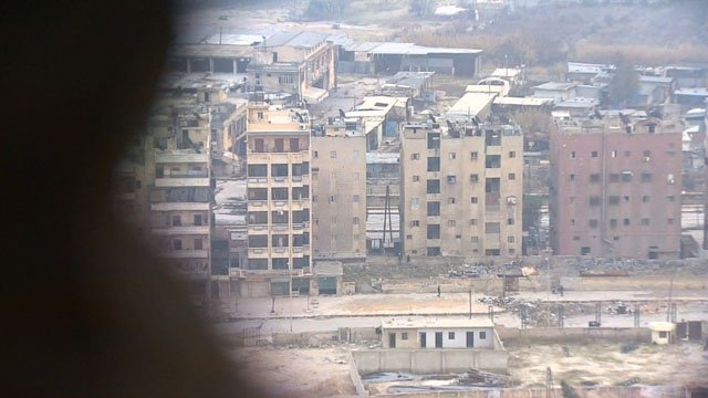 Residents, rebels leave besieged Syrian city