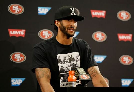 Kaepernick sits for anthem in protest of police violence. >