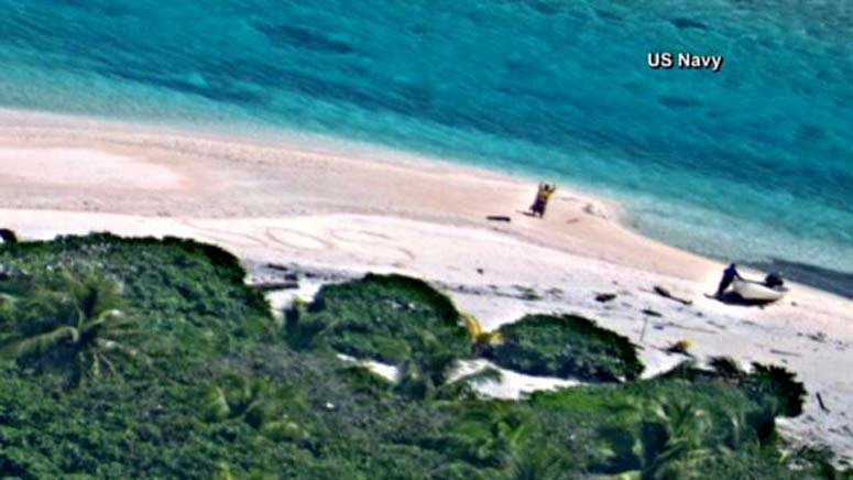 'SOS' in sand leads to rescue of 2 people stranded on island 7News