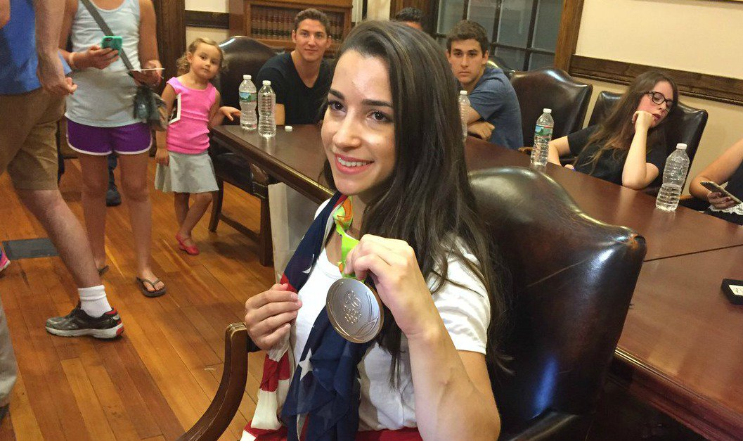 FinalFive gymnast Aly Raisman welcomed home with a 'Rally for Aly' after Rio2016 Olympics