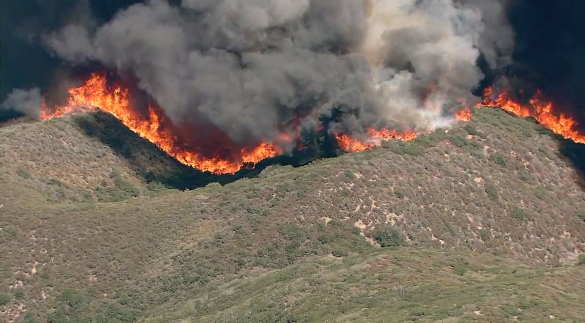#BlueCutFire in Cajon Pass (San Bernardino Co) is 9000 acres, 0% contained, 82,000 residents under mandatory evac. https://t.co/n44GyY2leC