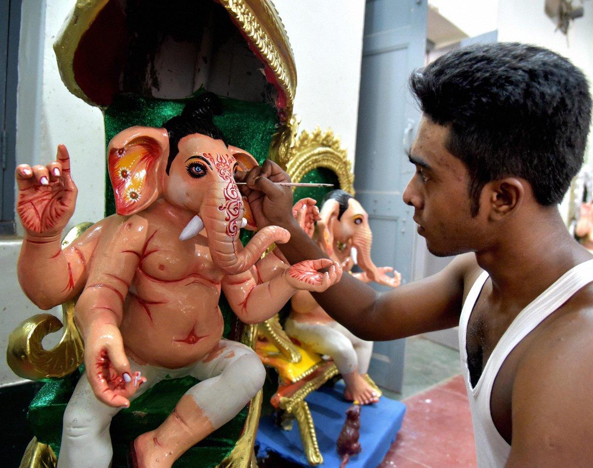 Lord Photo : Bangla artist final touches idols Lord Ganesha