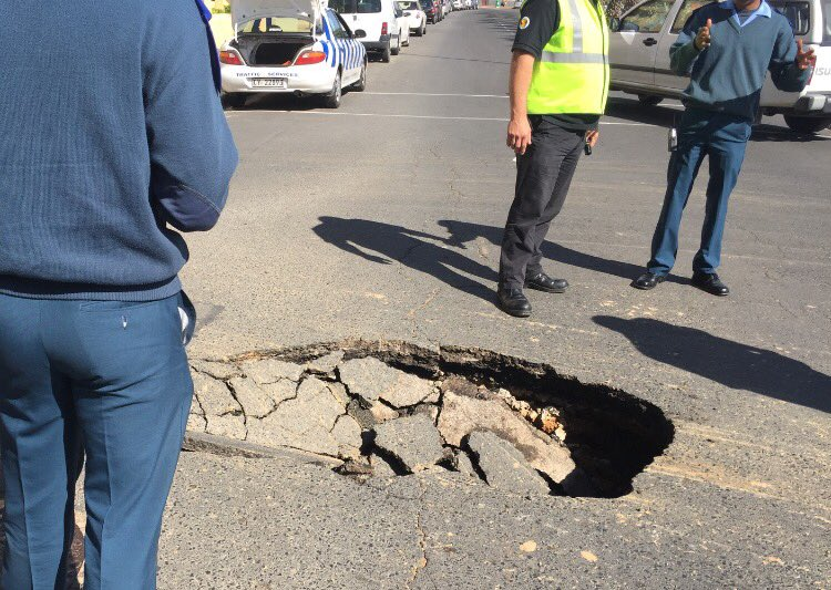 There is a sinkhole at the intersection of St. John's and Beach Roads in Sea Point. #DontSeeThatEveryDay