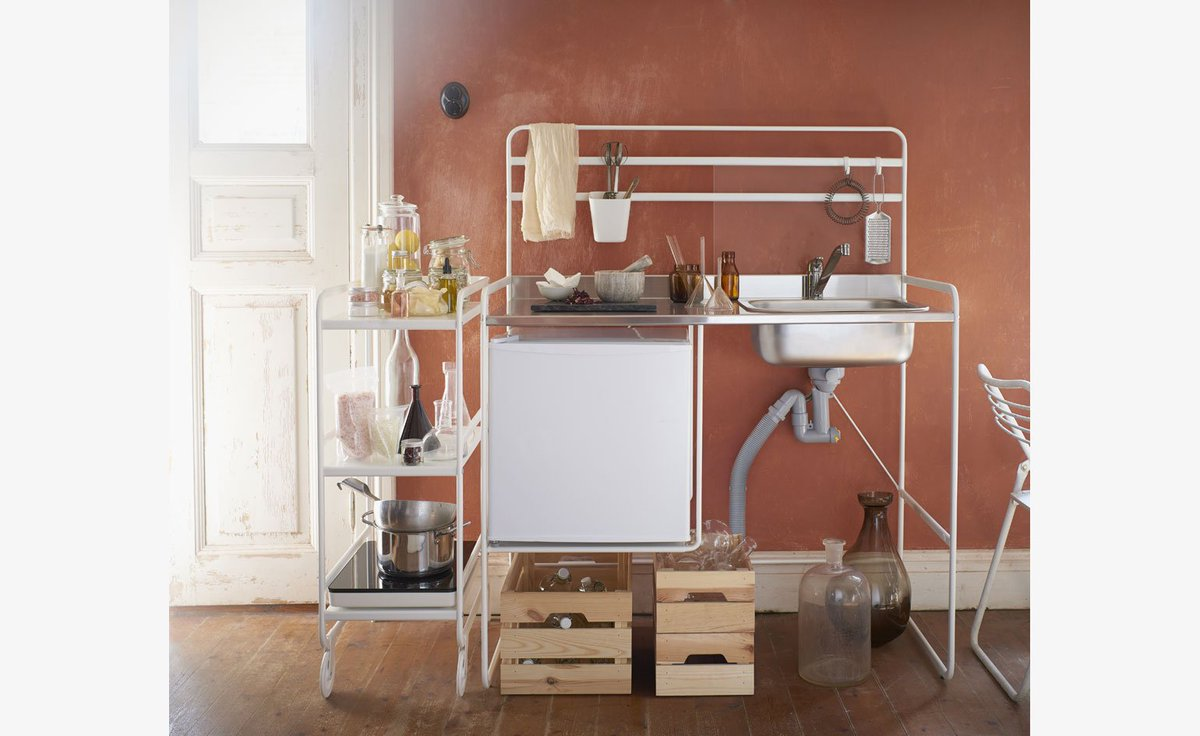 We're big fans of Ikea's moveable micro-kitchen: http://wlpr.co/QGJq1j