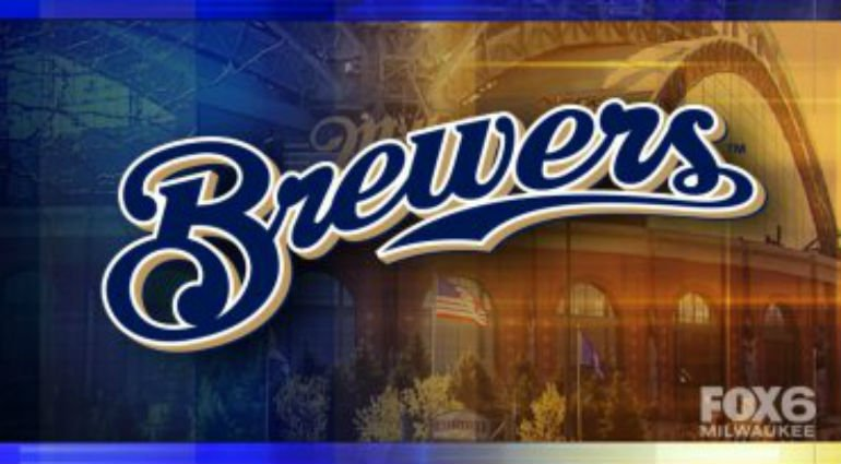 Woman struck in left ear by line drive down third base line during Brewers/Rockies game