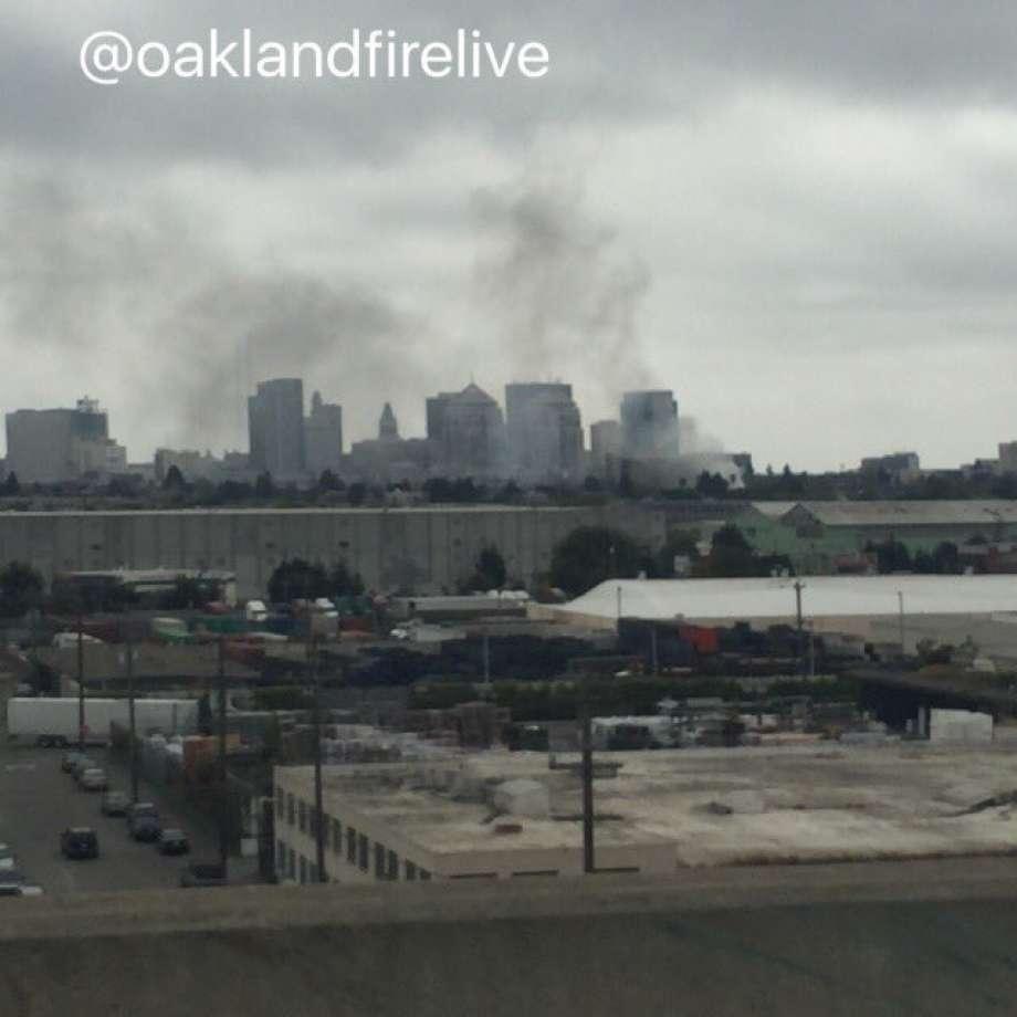 Firefighters battling fire near downtown Oakland