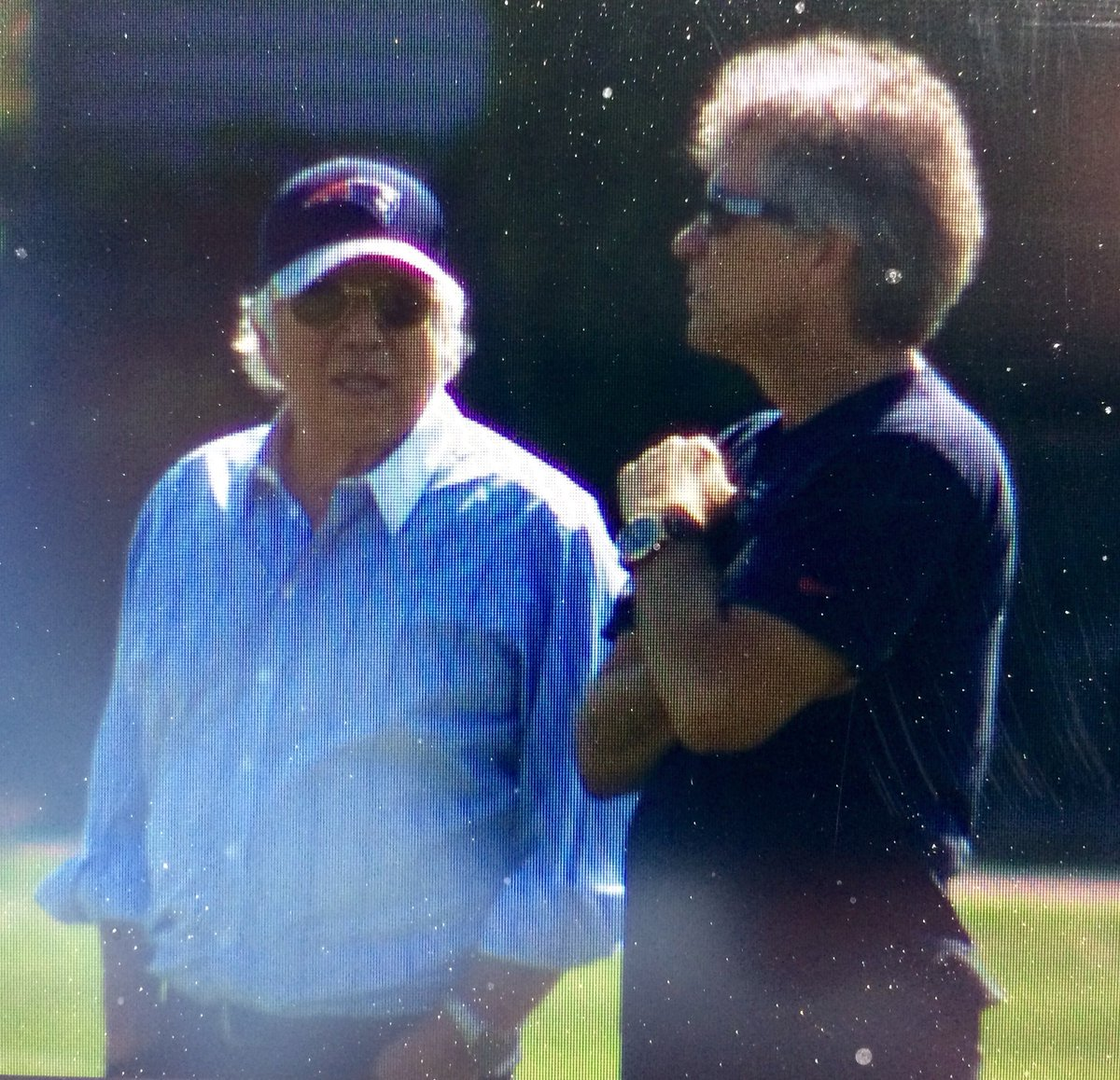 Jon Bon Jovi at Patriots practice today with owner Robert Kraft. No sign of a loaded six string on his back. WCVB