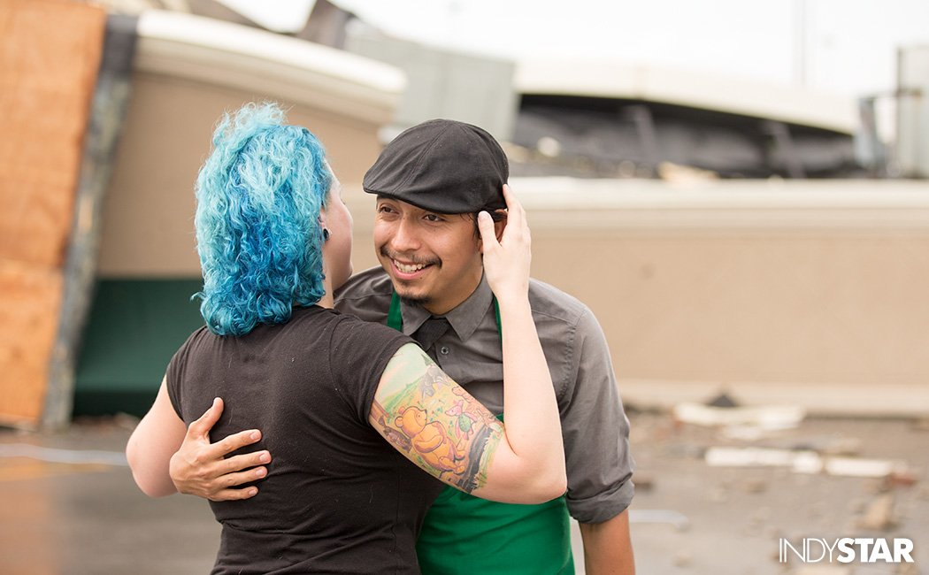 Starbucks worker Angel Ramos gets a hug after riding out twister with customers in the store's bathrooms.No injuries https://t.co/q88sdyY0ea