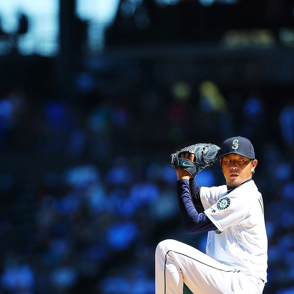 Seattle's Hisashi Iwakuma pitches in the third inning of the Mariners's game against the N…