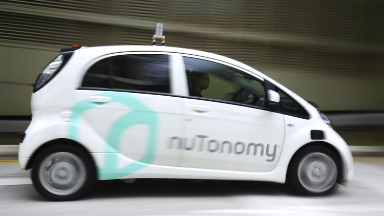 World's first self-driving taxis take to the congested roads of Singapore today