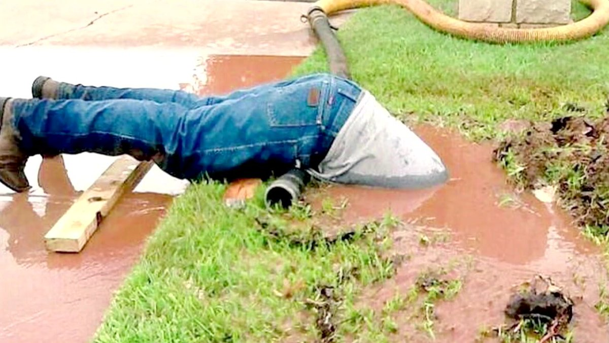 This utility worker is clearly not afraid to get a little dirty on the job