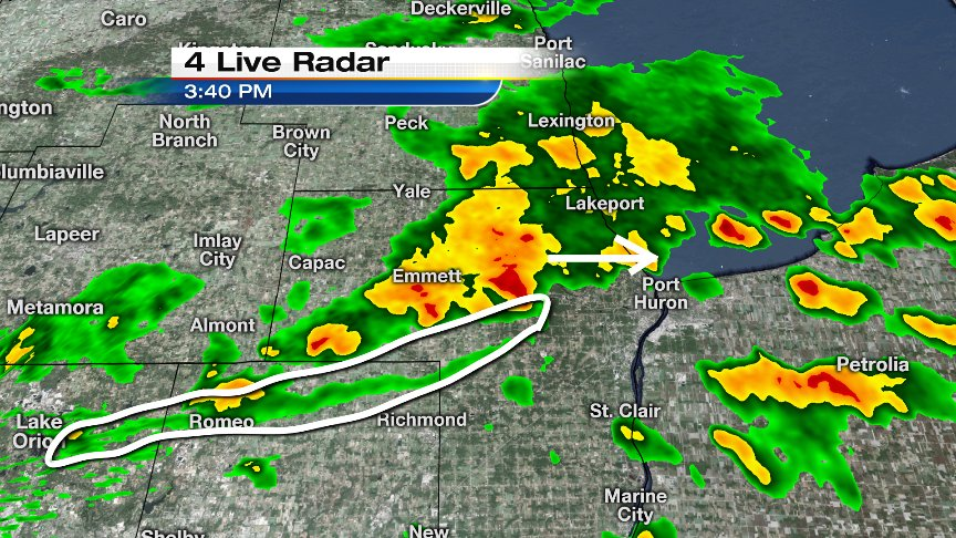 Solid downpours heading toward Port Huron. Circled item is an outflow boundary: possible line of gusty winds.