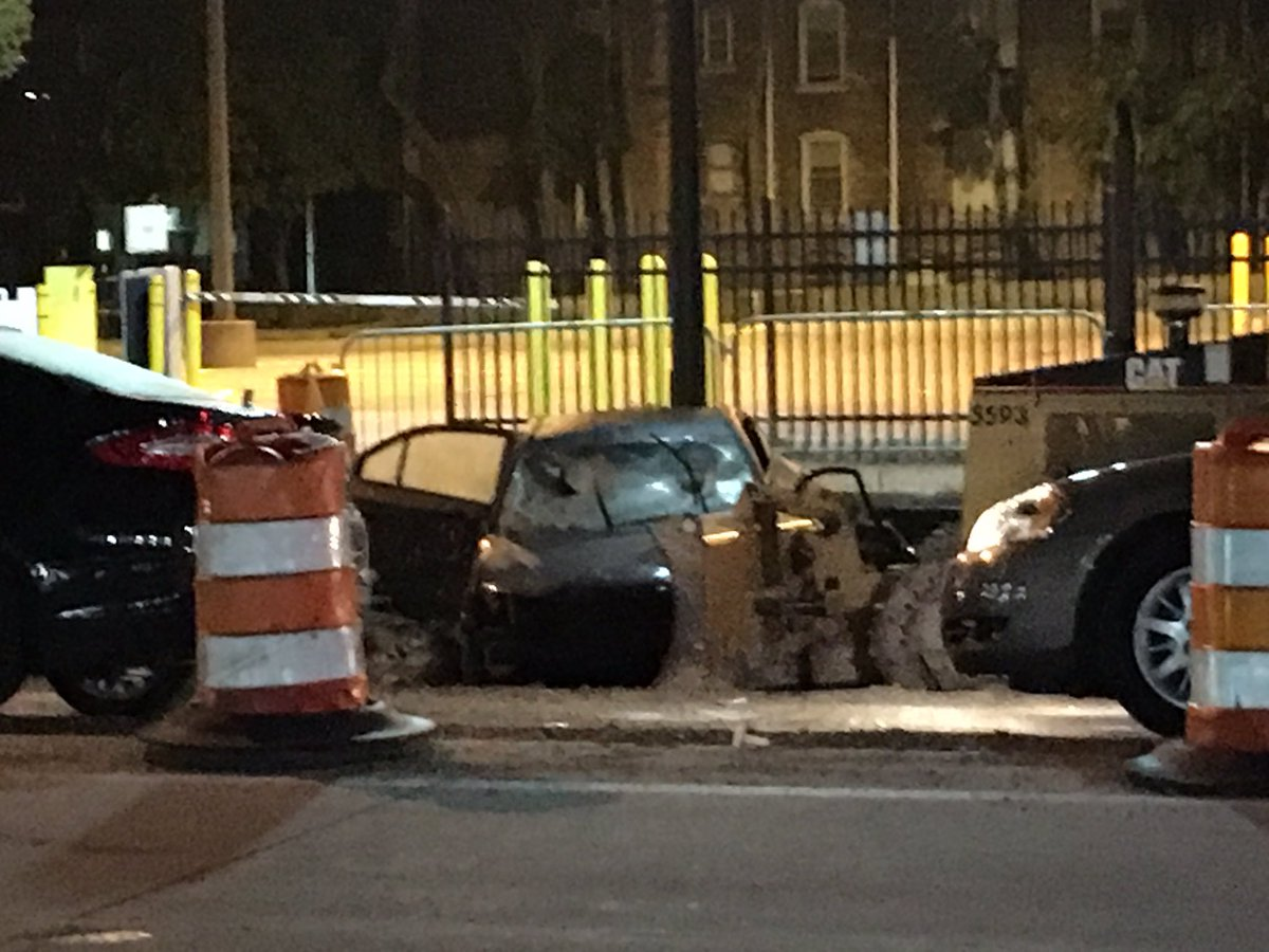 man crashed into M1 Rail construction, was shot in the chest. Driver died, pregnant passenger hospitalized