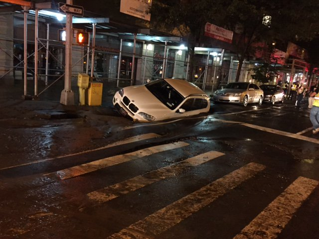 A water main broke on the UWS causing a sinkhole to open beneath a BMW near 89th and Amsterdam, stay tuned to NY1->