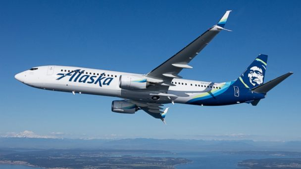 Man arrested after trying to open Alaska Airlines door mid-flight, police say