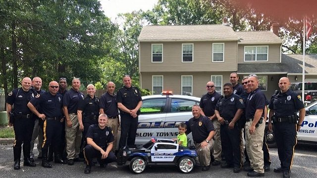 Police surprise boy who bought them lunch with mini police cruiser