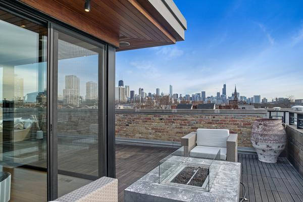 This East Lincoln Park $6.3M home has a heated indoor pool, wine cellar, and five wood decks