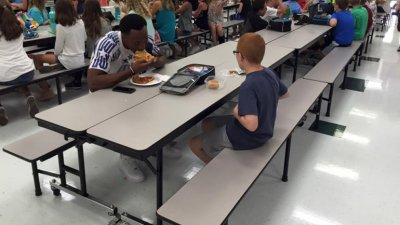 Florida State football player sees boy with autism sitting alone at lunch, joins him