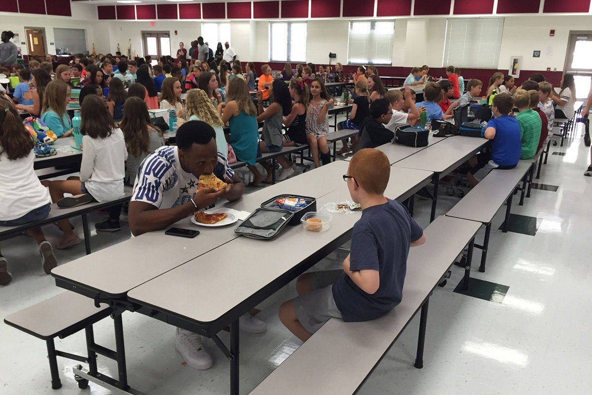 An FSU player saw an autistic boy eating lunch alone. So he asked if he could join him.