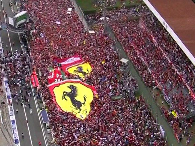 Formula 1: mare rosso Ferrari a Monza celebrando Rosberg Hamilton e Vettel