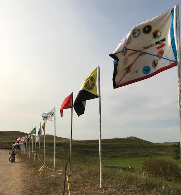 ancestors alongside. flags from forty-five different #Indigenous nations flying high at #StandingRock #NoDAPL https://t.co/bcjXU2qyLH
