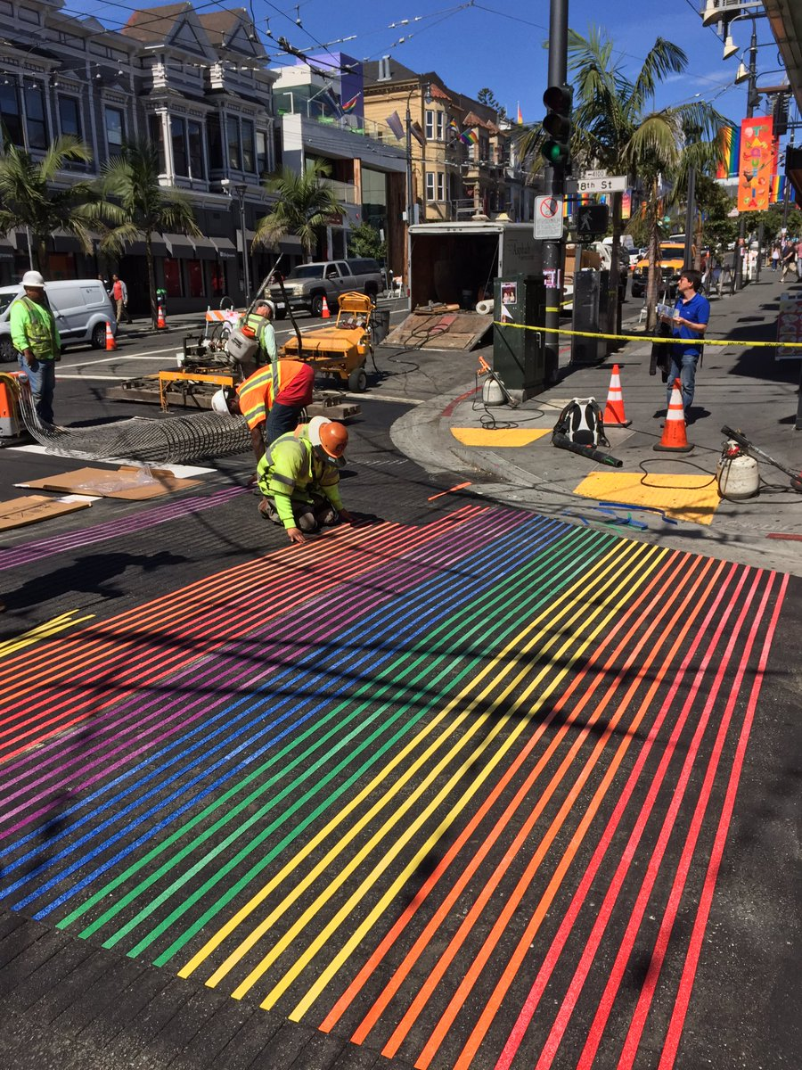 Crews lay down new rainbow stripes at 18th & #Castro intersection. #Pride. Unfortunately, no pot of gold at the end. https://t.co/cdHMCtaFTs