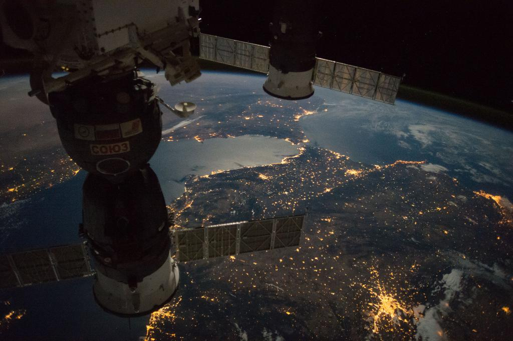 The moon, city lights and thunderstorms illuminate these nighttime views of Earth.
