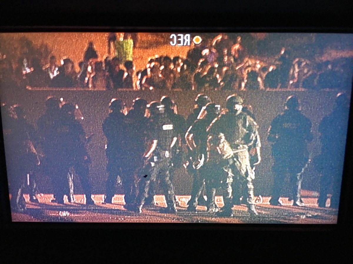 Protesters blocked I-85 overnight, looted trucks, & a nearby Walmart. Police used smoke/gas to disperse crowds #WCCB