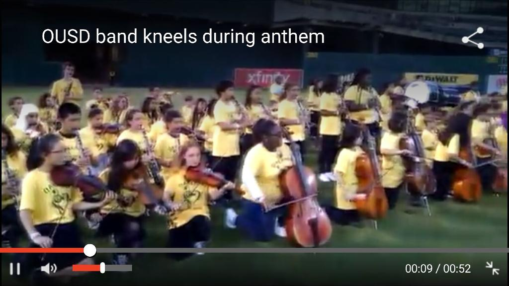 Oakland student band kneels in opposition to police brutality while playing the national anthem. #BLM https://t.co/A5krneexeB