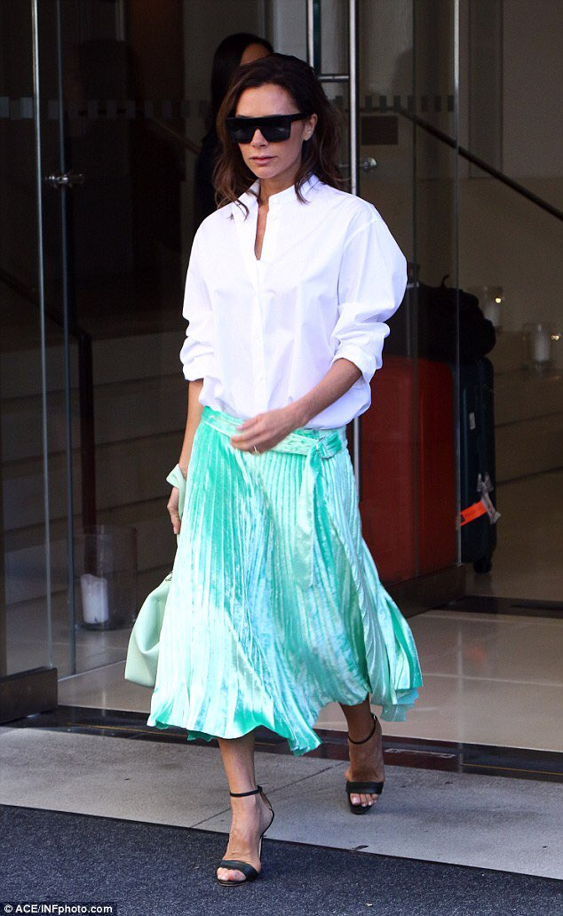 267cd6439 Victoria Beckham stepped out in NY wearing white blouse & mint green pleated  skirt..pic.twitter.com/sZzObsoEGa